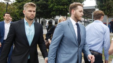 Edward Leaney and Jack Walker leave court in Sepang, Malaysia.