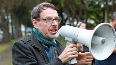 John Kaye addresses a TAFE cuts protest in 2014.