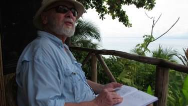 Professor Rick Shine taking field notes in the tropics.