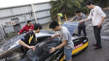 Record breaking: University of NSW students Kevin Moonyong Kim, Anthony Li, Gabriel Mendoza, Daniel Chen and James Sutanto prepare the Sunswift solar car.