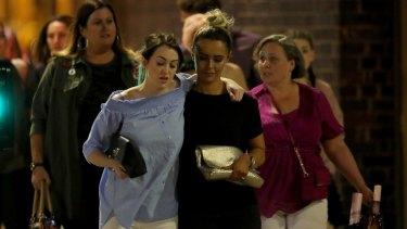 Shocked concert goers leave Manchester Arena after the blast.