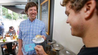 Former Sydney marketing executive Jono Fisher (left) purchased a coffee for a stranger as part of those leading a charge to cultivate compassion in everyday life. T