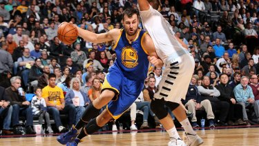 Aussies in the NBA: Andrew Bogut drives against the Denver Nuggets.