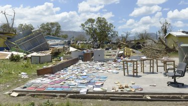 Books recovered from a school are left out to dry in Port Vila.