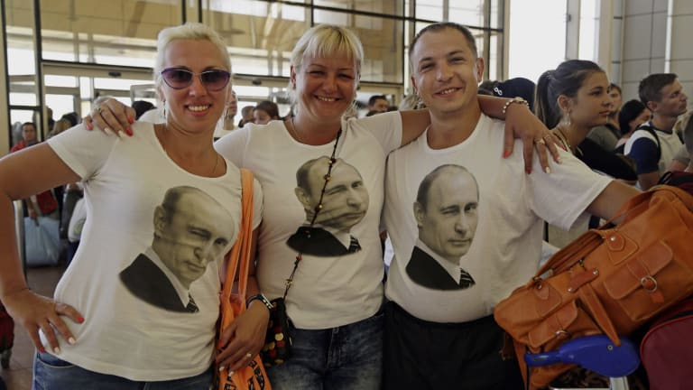 Russian tourists wearing T-shirts with images of Russian President Vladimir Putin pose for a photo in the departure terminal before boarding a flight from Sharm el-Sheikh, Sinai, Egypt, on Friday.