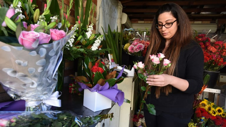 Florist Rita-Savannah Sakr at work in her garage after she had to close her shop when she wasn't paid by an online flower ordering company.