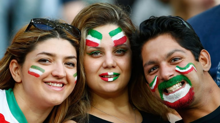 The joy of football ... Fans of IR Iran wait for the 2015 Asian Cup match with Qatar at ANZ Stadium in Sydney.