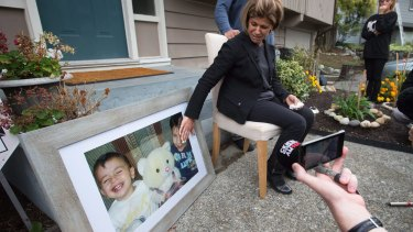 Teema Kurdi touches a photo of her nephews outside her home in Coquitlam, Canada, on Thursday.