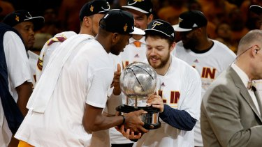 cf5be5e242a0 James Jones and Matthew Dellavedova of the Cleveland Cavaliers hold the  trophy after defeating the Atlanta
