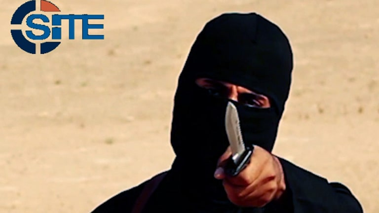 'Can you imagine the pain you'll feel when it cuts? Unimaginable pain' ... 'Jihadi John' - otherwise known as Briton Mohammed Emwazi - threatened Spanish reporter Javier Espinosa as he held a blade to his neck.