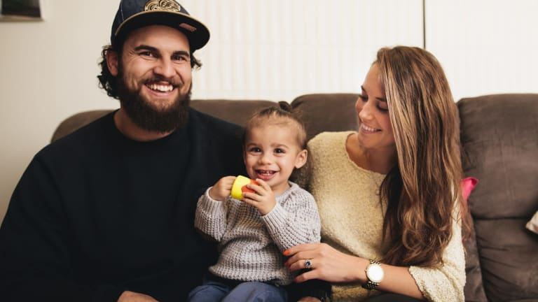 Jordan Smiler at home with his wife Stacey and son Keanu.
