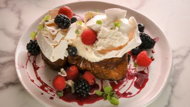Fried brioche is bejewelled with fresh berries and vanilla meringue.