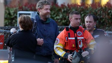 Louis Jordan, second from left, walks from the Coast Guard helicopter to the Sentara Norfolk General Hospital.