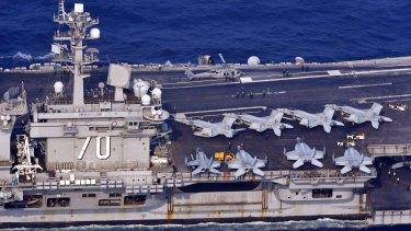 The USS Carl Vinson sails off  Nagasaki prefecture, southern Japan on Saturday.