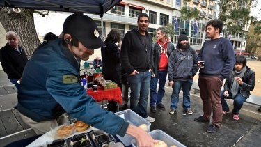 Greg Geering (centre) at the city food stall.