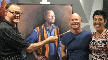 David Hinchliffe in his studio with Campbell and Lisa Newman and his portrait of the former premier.