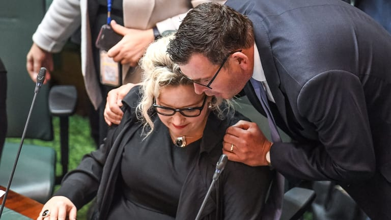 Premier Daniel Andrews congratulates Health Minister Jill Hennessy after the vote.