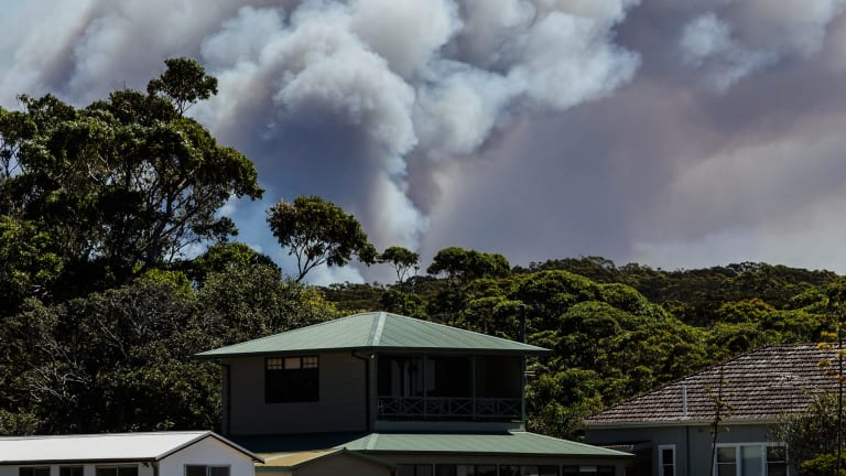 An out-of-control bushfire burning in the Royal National Park, as seen from Bundeena.