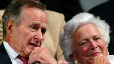 Former president George H.W. Bush and former first lady Barbara Bush listen as their son accepts the party nomination at the Republican National Convention in New York, 2004.