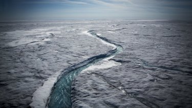 Meltwater flows along a supraglacial river on the Greenland ice sheet, one of the Earth's biggest and fastest-melting chunks.
