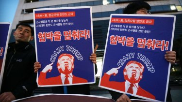 South Korean protesters denounce US policy against North Korea, at a rally near the US Embassy in Seoul.