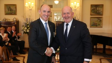Busy man ... Stuart Robert is sworn in as Minister for Human Services and Minister for Veterans' Affairs by Governor-General Sir Peter Cosgrove in September.