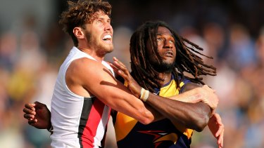 Tight tussle: Tom Hickey and Nic Naitanui during a ruck contest.