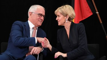Prime Minister Malcolm Turnbull and Foreign Minister Julie Bishop shake hands during the official launch of the 2017 foreign policy white paper on Thursday.