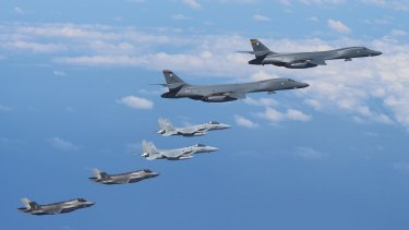 This photo, released by the US Pacific Command on Sept. 1, 2017, shows US Air Force B-1B strategic bombers and U.S. Marine Corps F-35B stealth jets flying over the Korean Peninsula.