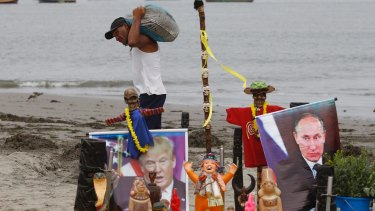 An altar featuring an image of Donald Trump and Vladimir Putin, set up by a group of shamans for their annual pre-New Year ceremony at Agua Dulce, Peru. The shamans have warned their vision of 2017 were filled with doom and gloom.