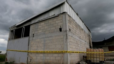 A police cordon is seen at a warehouse where a tunnel, connected to the Altiplano Federal Penitentiary and used by drug lord Joaquin 'El Chapo' Guzman to escape, ended.