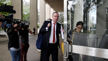 Legal representatives arrive at the High Court in Canberra on Tuesday.
