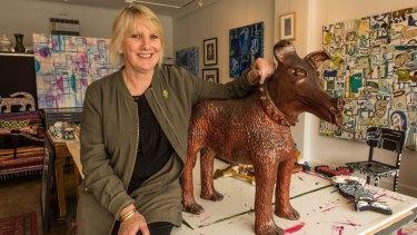 Bentleigh-based artist Pamela Irving with her sculpture Larry La Trobe the dog.