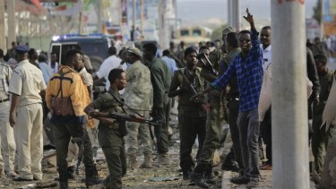 Security forces gather at the scene following a suicide car bomb attack in Mogadishu on Sunday.