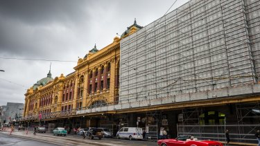 The ugly building hoarding at Flinders Street Station will not be changed under council's proposal.