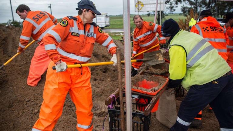 NSW SES crews fill sandbags at SES headquarters in Forbes in preparation for the rain that is expected to fall in the coming days.