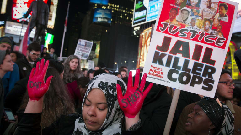 A 2014 protest against a grand jury's decision on Monday not to indict Ferguson police officer Darren Wilson in the shooting of Michael Brown in New York.