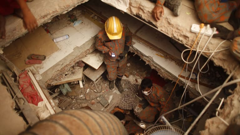 Rescue workers in the Rana Plaza factory after the collapse that killed 1129 workers.
