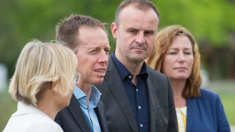 The Greens' Caroline Le Couteur and Shane Rattenbury, with ACT Chief Minister Andrew Barr and deputy Yvette Berry announcing the parliamentary deal at the Lyneham wetlands on Sunday.