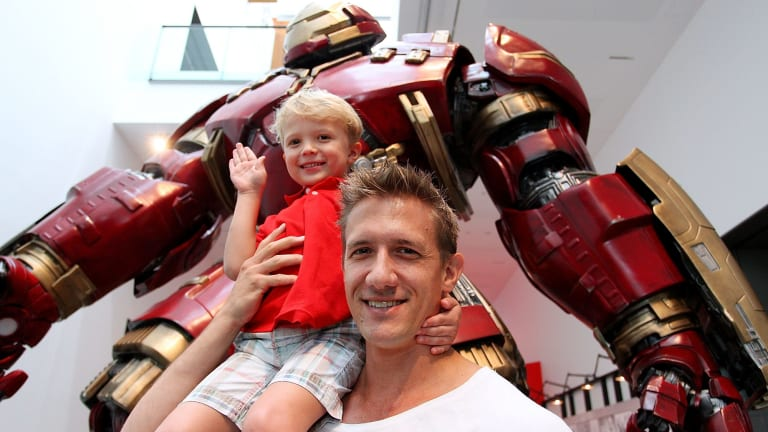 Nicolas Pougnet and son Lucas, 4, visit the Marvel exhibition at GOMA.