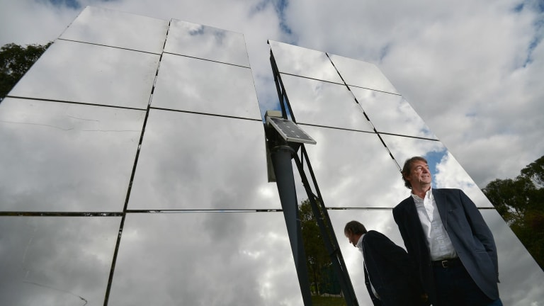 John Lasich, chief technology officer at RayGen, stands in front of mirrors used to concentrate sunlight onto a highly efficient solar receiver to produce electricity under the Victorian-based project.