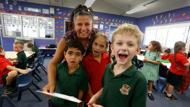 Indigenous language classes at Dubbo West Public School: Dianne McNaboe, teacher of Aboriginal language and culture, with Bryson (left), Lily and Thomas singing a song.