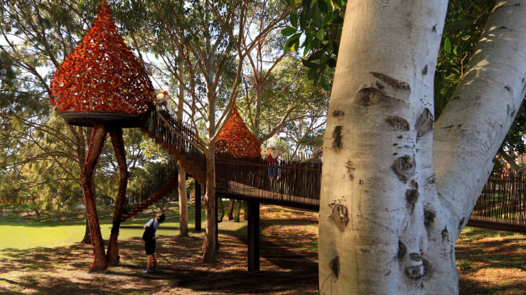 The treehouses appear to be wandering across the park in this artist's impression.