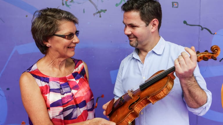 Vicki Olsson with concertmaster Andrew Haveron and the 1757 Guadagnini violin that she has loaned to the Sydney Symphony Orchestra.