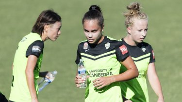 Australian and Canberra United defender Emma Checker [middle] can't tale a trick after another injury setback.