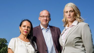 Pledge to reverse cuts to victim payouts: Sexual assault victim, Katrina Keshishian (right) with Labor MP Luke Foley and Labor MP Linda Burney at the Domain.