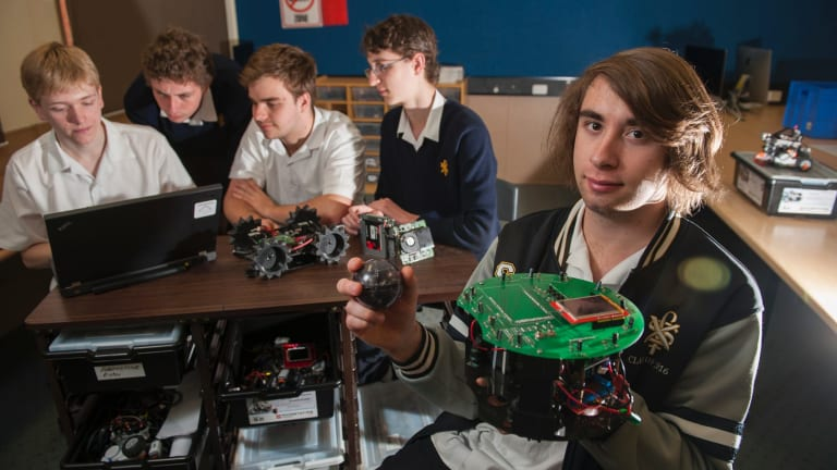 Year 12 student Robert Kaz 18 (right) with his team's soccer robot will be competing in the Robocup Junior Australian Championships next weekend in Sydney, with fellow students Aaron Maggs, Matthew Williams, Riley Cockerill and Jack Williams with their rescue robot.
