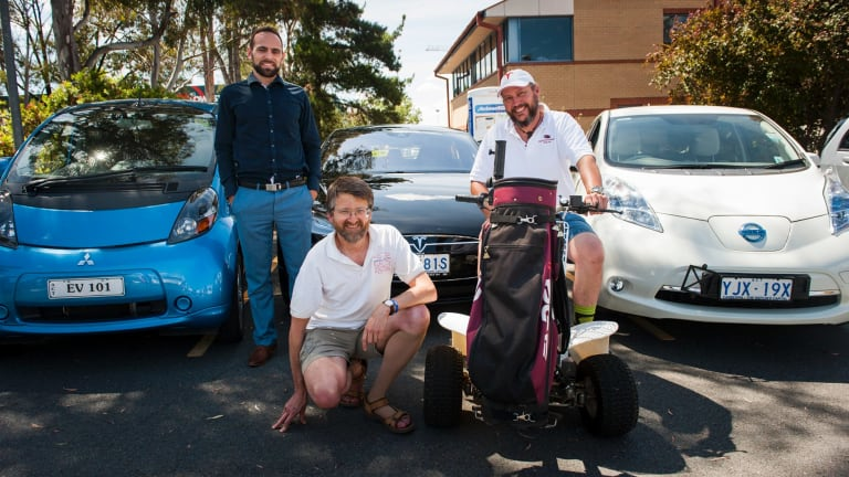 Tesla car owner, Slava Kozlovskii with members of the Canberra electric vehicle association, Peter Campbell and Mark Hemmingsen take part in the Renewable Energy Day in Tuggeranong.