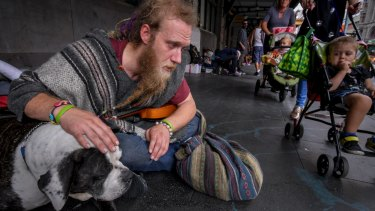 Glen, 32, with his dog, Tonka, at the Flinders Street Station camp.