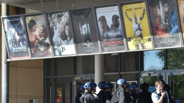 Movie posters outside the cinema.